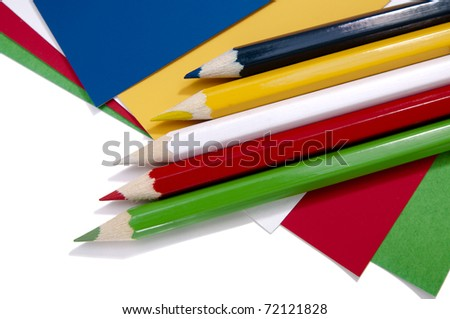 Five pencils on as many pieces of paper in different colors. Back to school theme