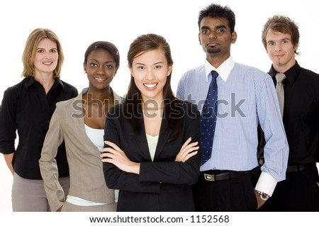 Five people make up a diverse business team - stock photo