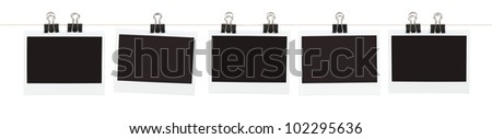 Five pieces of blank film held on a string with binder clips isolated on white. - stock photo