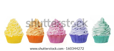 five rainbow cupcakes isolated on a white background for cutout