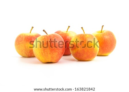 five red apples on a white background - stock photo