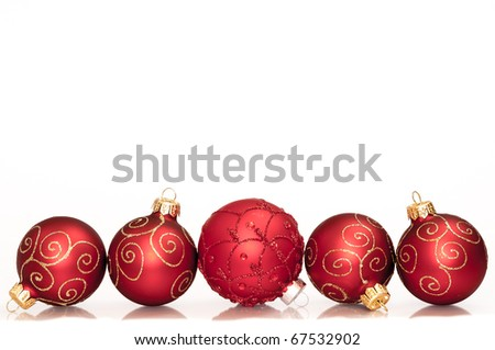 Five red christmas decoration ball on a white background - stock photo