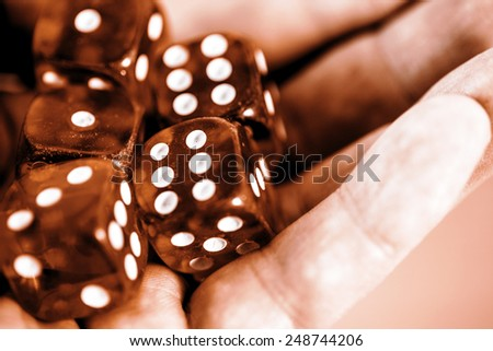 five red dice in the hand - six, one, three - stock photo