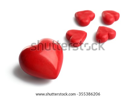 Five red hearts, isolated on white