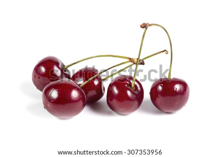 Five ripe red cherries isolated on white