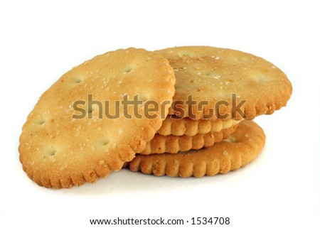 five salty crackers stacked over white - stock photo