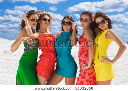 Five sexy girls closeup on the snow ready for party - stock photo