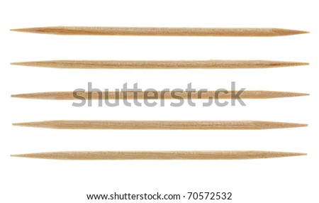 Five single toothpicks, isolated on white - stock photo