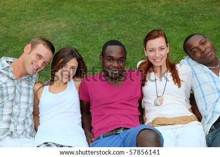 five smiling young people of various origin are happy