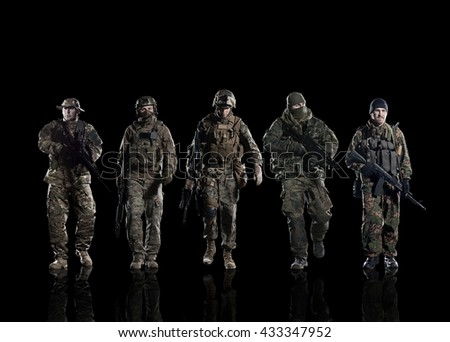 Five soldiers of different armies on the smooth floor. Isolated on black - stock photo