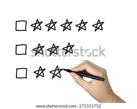 five star rating drawn by human hand over white background - stock photo