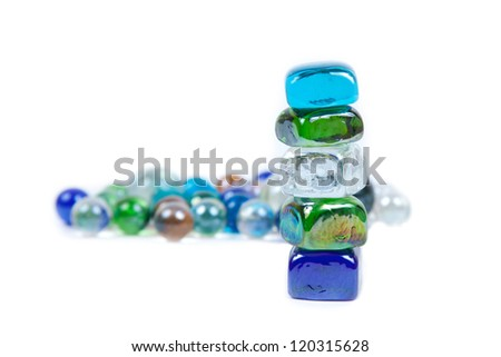 five stones are teetering on the background of round stones