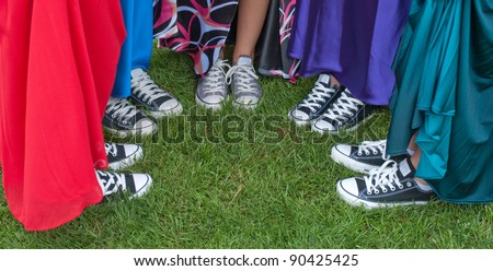 five teenage girls show off the more comfortable prom shoes - stock photo