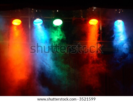 five theater lights with smoke - stock photo