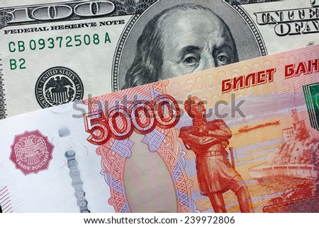 Five thousand rubles and one hundred dollars. Closeup.