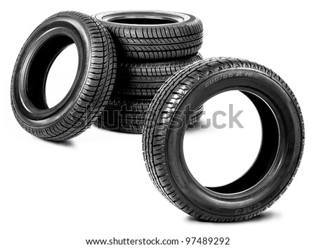 Five tires isolated on the white background - stock photo