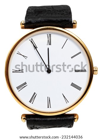 five to twelve o'clock on dial of wristwatch isolated on white background - stock photo