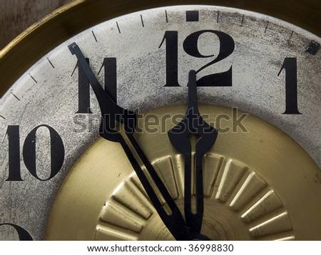 five to twelve  on old clock - stock photo