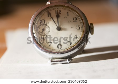 five to twelve, time on vintage clock - stock photo
