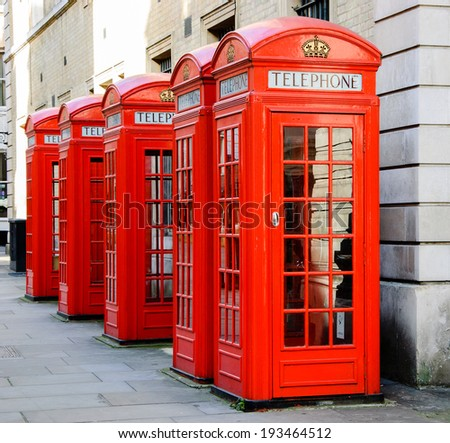 Five traditional old style red phone boxes in London, UK. - stock photo