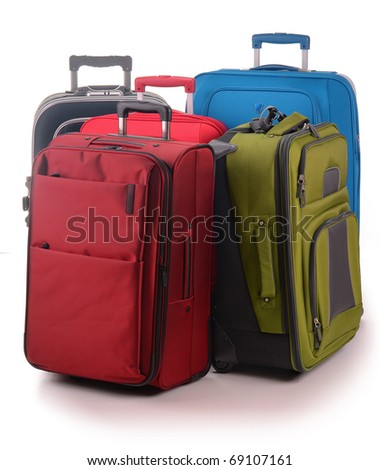Five travel suitcases isolated on white