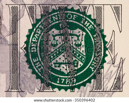 Five us dollar bill fragment with treasury seal macro, united states money closeup - stock photo