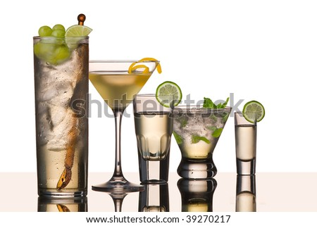 five vodka drinks on glass surface with reflection, white background