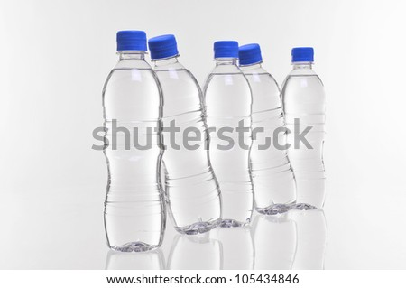 five water bottles with two at an angle - stock photo