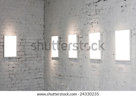 Five white empty frames on exposition - stock photo