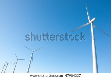 Five windmills in a row on sunny day, copenhagen, oresund, denmark - stock photo