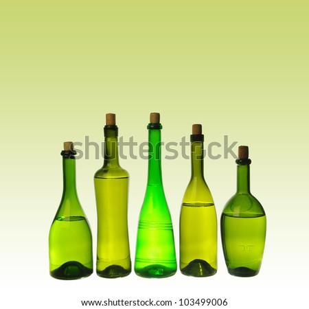 Five wine bottles  on brown   background.