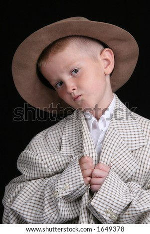 five year old boy plays dress-up in over-sized suit - stock photo