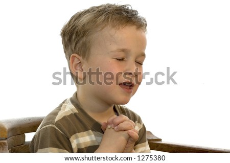 Five year old boy praying and singing