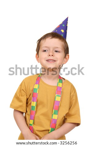 five years old boy in party hat isolated on white