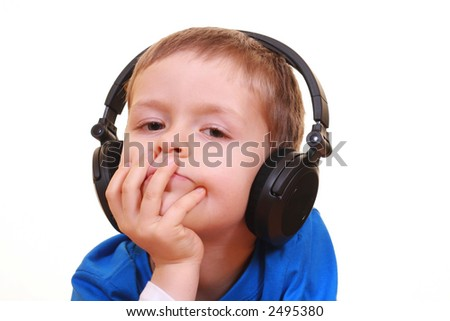 five years old boy with headphone isolated on white