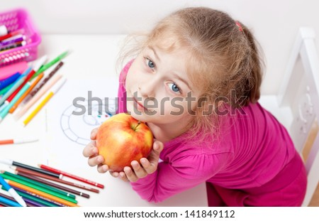 Five years old caucasian blond child girl with apple - stock photo