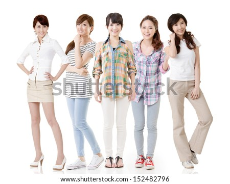 Five young asian beautiful women posing for the camera. Full length portrait. Isolated on the white background.