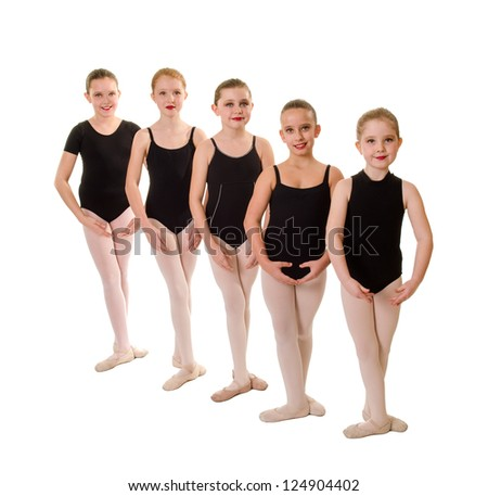 Five Young Female Ballet Students with Feet in Third Position - stock photo