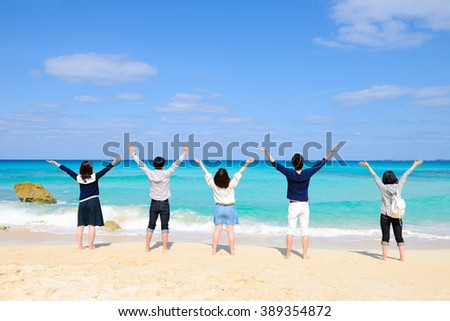 Five young people a view of the sea - stock photo