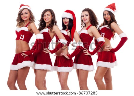 five young sexy Santa women isolated on white