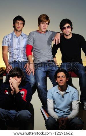 Five young trendy teenagers group posing together - stock photo