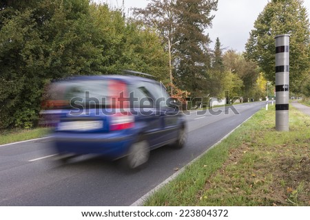 Fixed modern radar speed camera on federal highway in Germany - stock photo