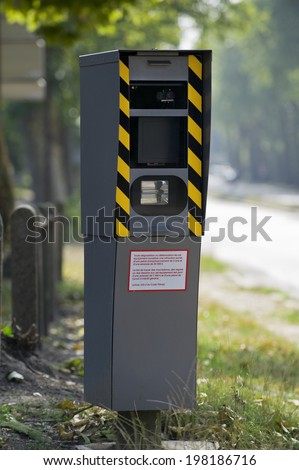 Fixed radar checking speed limit about car on the road - stock photo