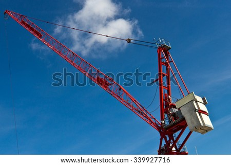 Fixed tower crane for construction - stock photo