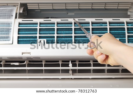 Fixing air conditioner - stock photo