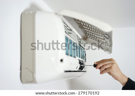 fixing and maintaining air conditioning system - stock photo