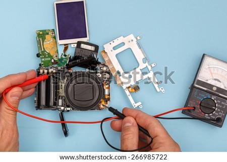 fixing broken camera - stock photo