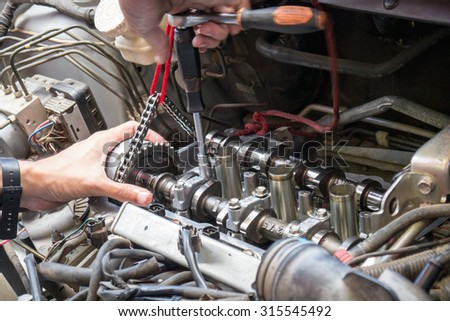 Fixing car engine using local method and simply tools found in local part of Thailand