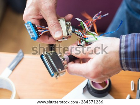 Fixing computer cable - stock photo