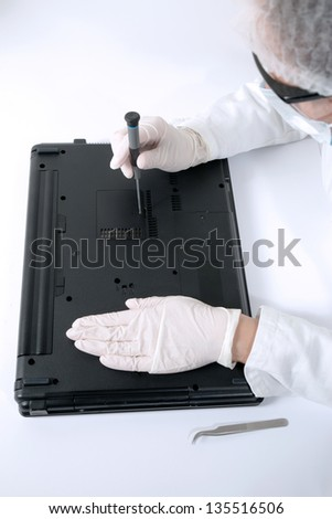 Fixing computer problem - stock photo